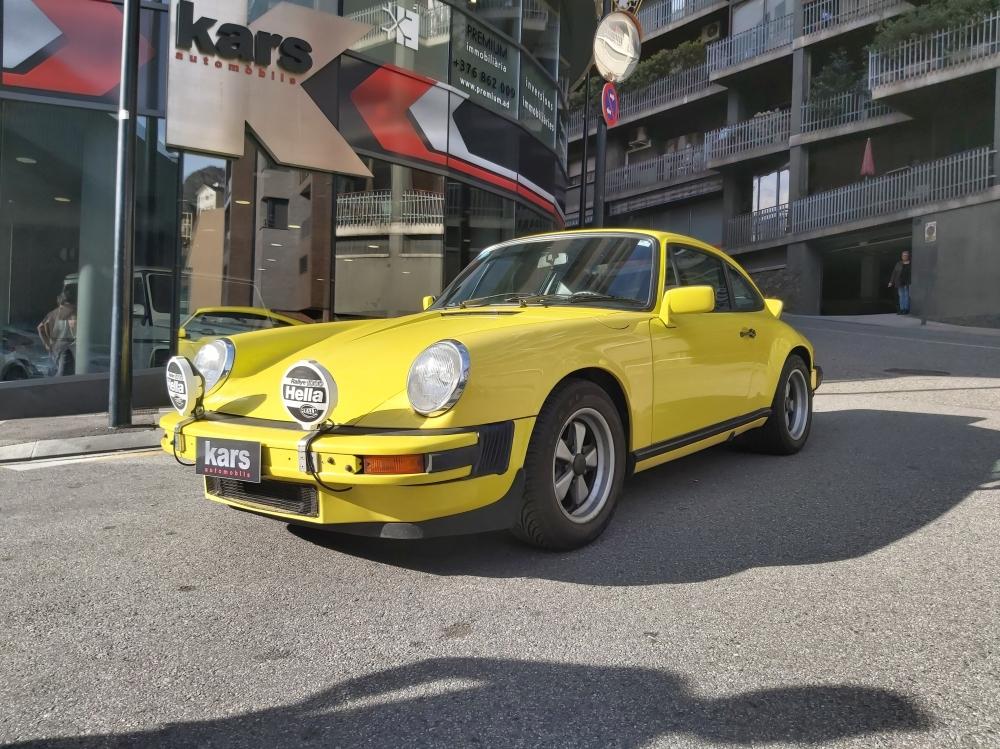 Porsche - 911   149.911 €